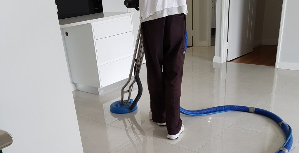 A worker's cleaning grout